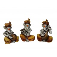 Ganesha In Brown Color Playing Instruments