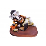 Wooden Ganesha doing Business on Laptop