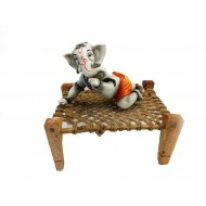 Orange and White Ganesha Resting on Cot