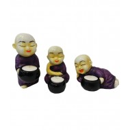 Purple Monks Candle Holders